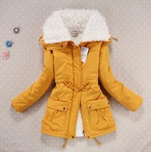 Dámská zimní prošívaná žlutá bunda s kožíškem